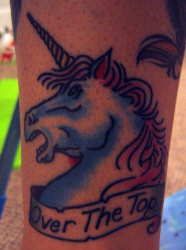 Over the top unicorn head tattoo