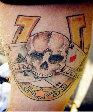 Horseshoe skull and cards tattoo on luck