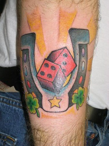 Lucky horseshoe and red dice tattoo