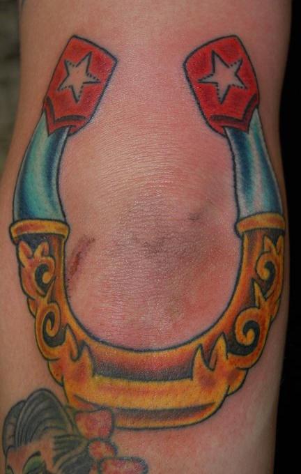 Classic horseshoe coloured tattoo
