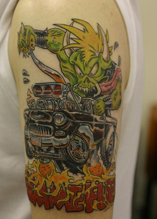 Green ork on hot rod coloured tattoo