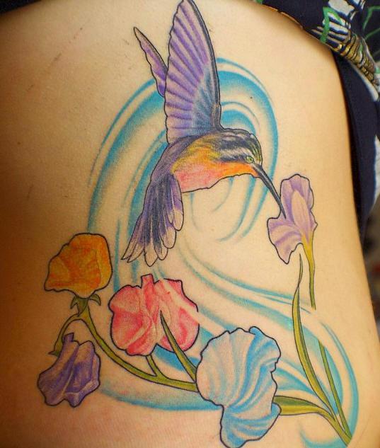 Elegant hummingbird lady tattoo