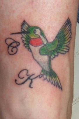 Hummingbird with initials tattoo