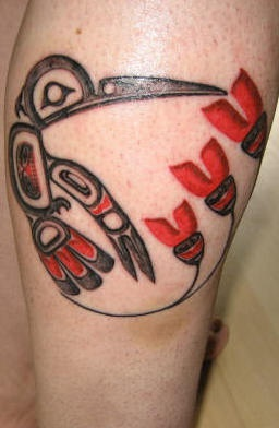 Tribal style hummingbird tattoo