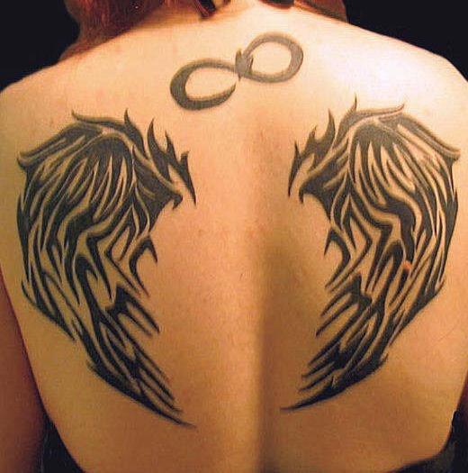 Infinity symbol and wings tattoo