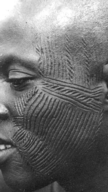 Intricate skin scarification on face
