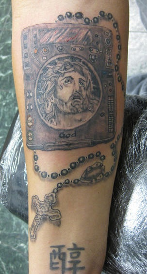 God book and rosary beads tattoo