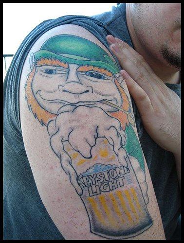 Leprechaun woth beer advertisment tattoo