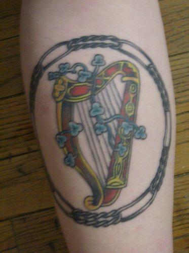 Detailed irish harp tattoo