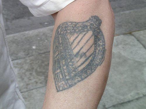 Irish harp black ink tattoo