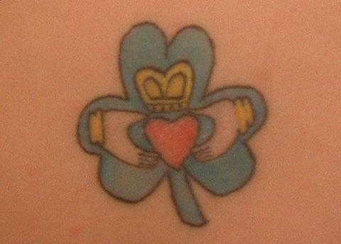 Claddagh symbol in clover tattoo