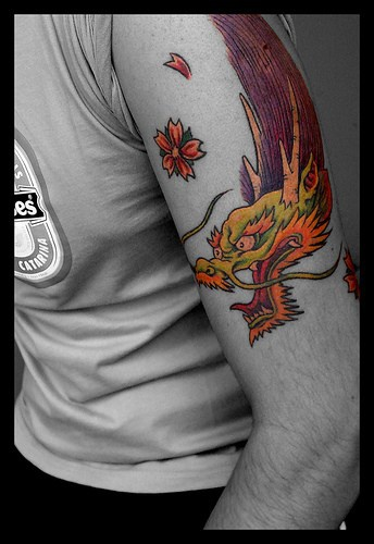 Coloured flying japanese dragon tattoo