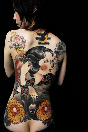Japanese noir lady with yellow flowers full back tattoo