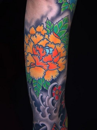 Asian style orange flower in sea tattoo