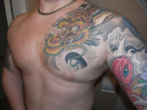 Yellow japanese dragon in sky tattoo