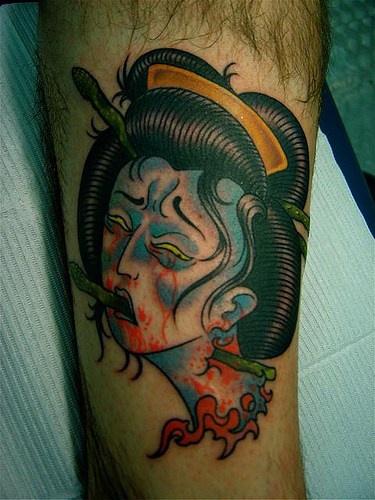 Dead japanese geisha head tattoo for Asian face tattoos