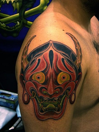 Red oni demon face tattoo