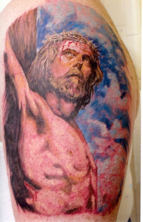 Colourful jesus crucifixion tattoo