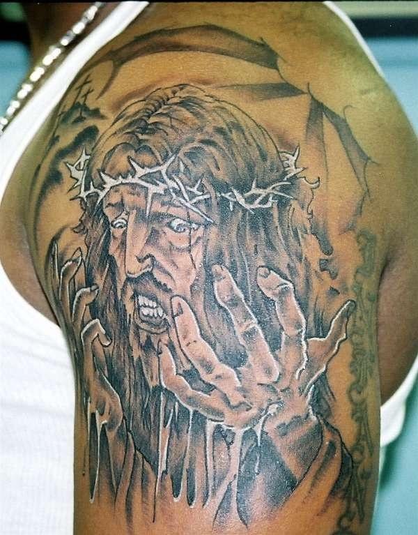 Jesus pain black ink tattoo on shoulder