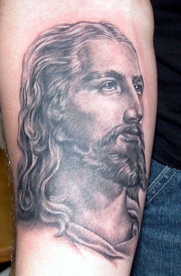 Jesus profile black ink tattoo