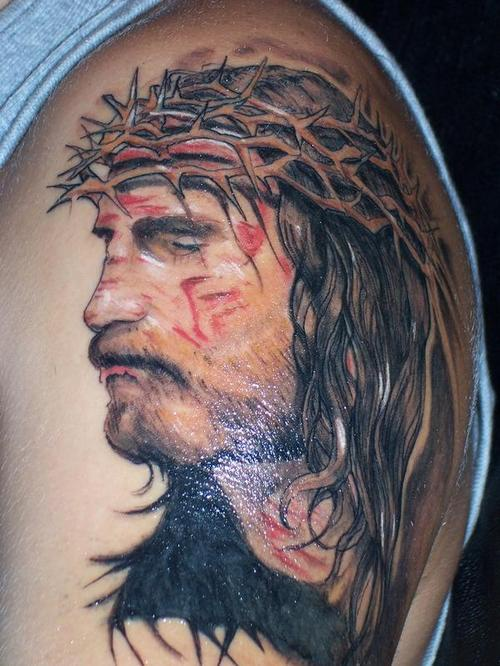 Tortured Jesus in blood tattoo