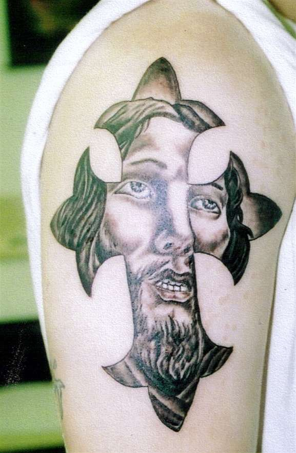 Jesus face in cross tattoo