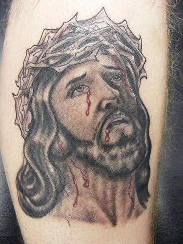 Jesus in crown of thornes with blood black ink tattoo