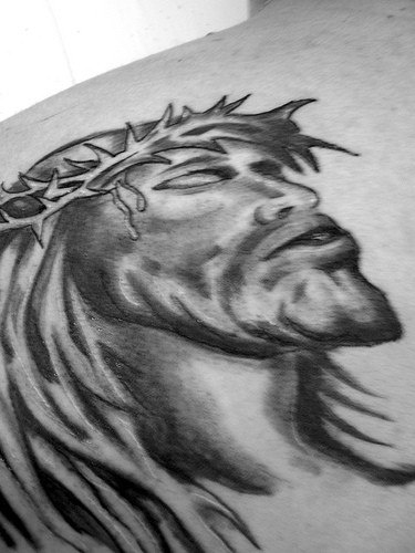 Jesus in crown of thornes black ink tattoo