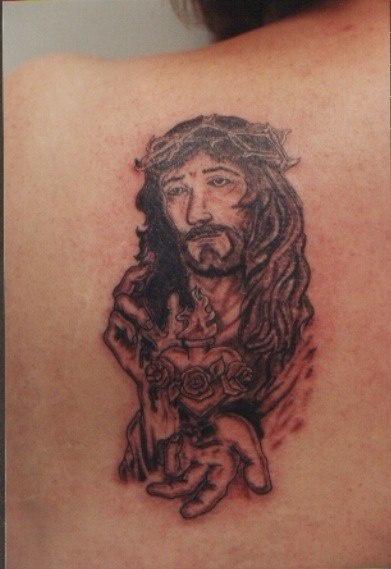 """gesu"""" tatuaggio sulla schiene inchiostro nero"""
