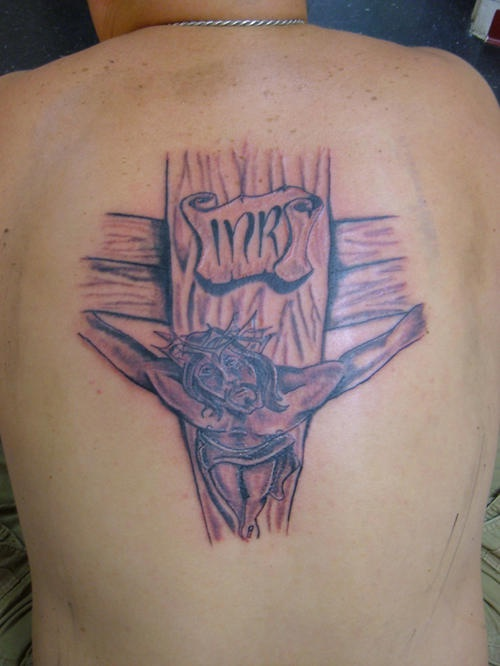 Jesus on wooden cross tattoo on back