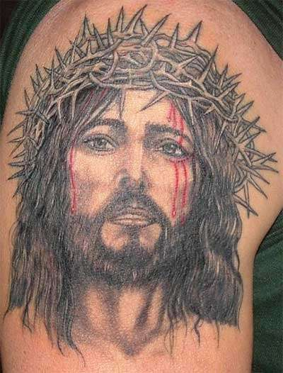 Jesus in crown of thornes tattoo