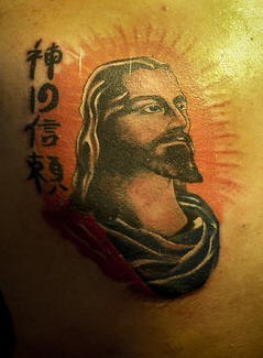 Jesus head with chinese symbols tattoo