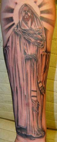 Jesus in cloak with shining tattoo