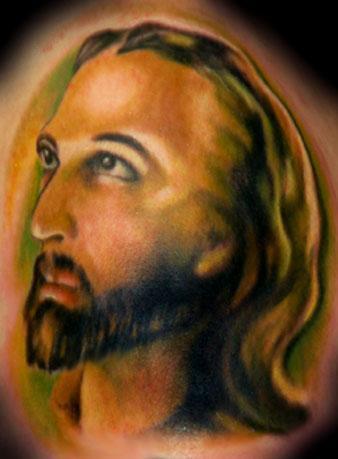 Jesus face bad coloured tattoo
