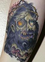 Zombie jesus head tattoo