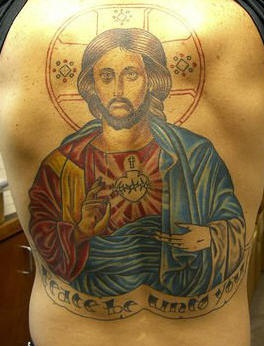 Large jesus and sacred heart tattoo on back