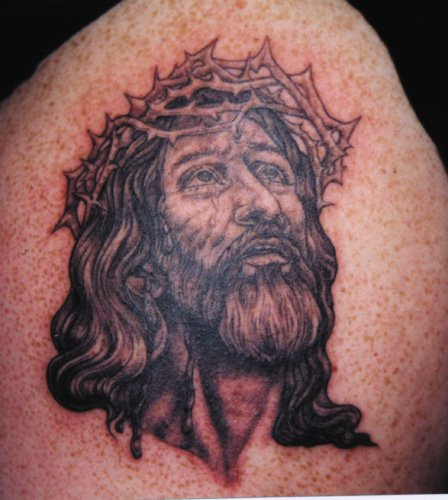 Jesus in crown of thornes black tattoo