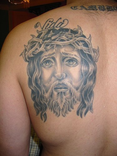 Jesus face tattoo on back