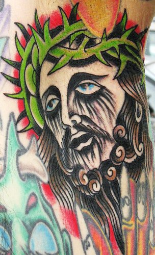 Jesus face coloured traditional tattoo