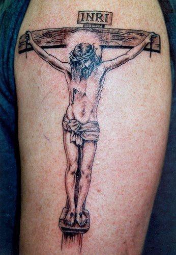 Jesus crucufixion tattoo on arm