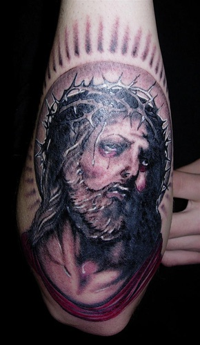 Tortured jesus with shining tattoo