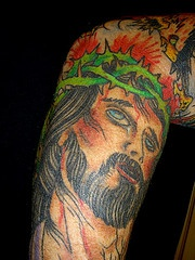 Colourful Jesus in crown of thornes tattoo