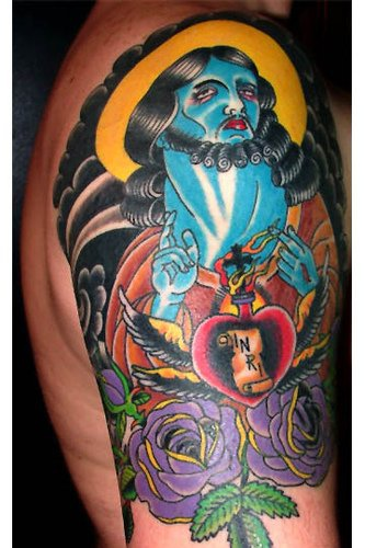 Surreal and colourful Jesus tattoo