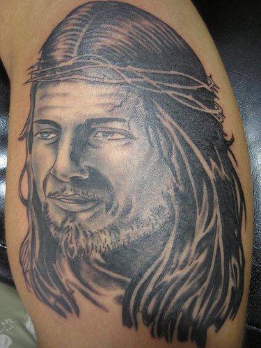 Strange glad Jesus tattoo