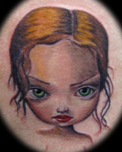 Cartoonish kid coloured  tattoo