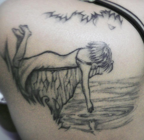 Girl on river side tattoo
