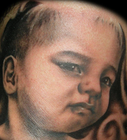 Little kid tattoo made from photo