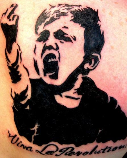 Agressive kid black ink tattoo