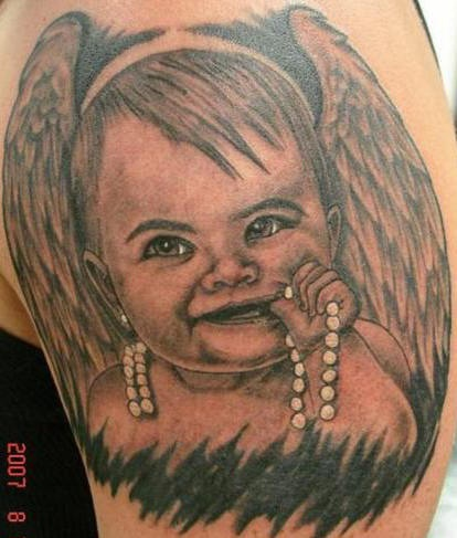 Child with wings tattoo