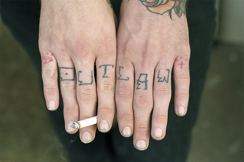 Knuckle tattoo, outlaw, little briliant and cross